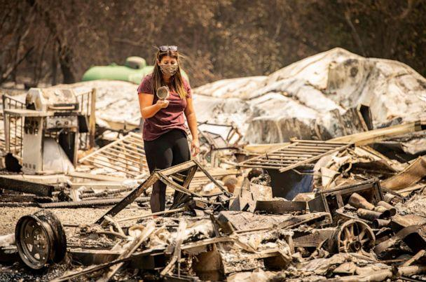 PHOTO: Resident Alyssa Medina reacts after finding an intact cup amidst the burned remains of her home during the LNU Lightning Complex fire in Vacaville, Calif., Aug. 23, 2020. (Josh Edelson/AFP via Getty Images)