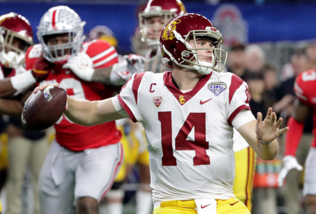 FILE - In this Dec. 29, 2017, file photo, Southern California quarterback Sam Darnold (14) throws a pass with teammates providing blocking against Ohio State during the first half of the Cotton Bowl NCAA college football game in Arlington, Texas. Every quarterback prospect in the upcoming NFL draft has a major flaw or drawback that keeps them from being the consensus best one of the bunch. (AP Photo/LM Otero, File)