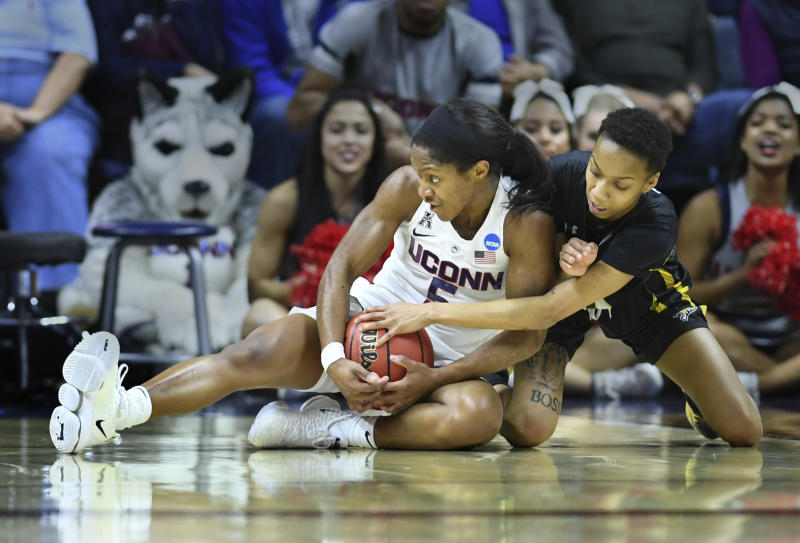 Connecticut's Crystal Dangerfield (5) battles for the ball against Towson's Qierra Murray (11) during a first round women's college basketball game in the NCAA Tournament, Friday, March 22, 2019, in Storrs, Conn. (AP Photo/Stephen Dunn)