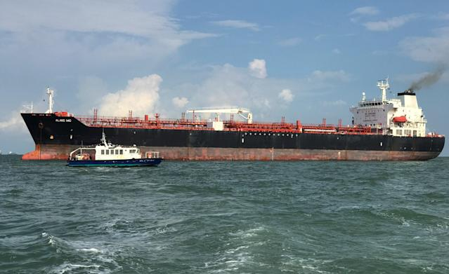 <p>Tanker Alnic MC is seen in Singapore waters after a collision with U.S. Navy USS John S. McCain, Aug. 21, 2017. (Photo: Christoph Van Der Perre/Reuters) </p>