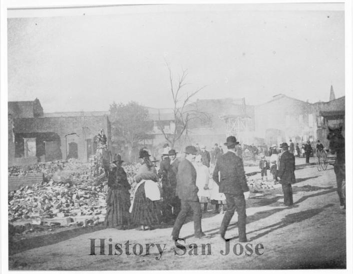 """This 1887 photo provided by History San Jose, part of the History San Jose Photographic Collection, shows Market Street in Chinatown just after an arson fire in San Jose, Calif. More than a century after arsonists burned it to the ground in 1887, the San Jose City Council on Tuesday, Sept. 28, 2021, unanimously approved a resolution to apologize to Chinese immigrants and their descendants for the role the city played in """"systemic and institutional racism, xenophobia, and discrimination."""" (San Jose Research Library & Archives/History San Jose via AP)"""