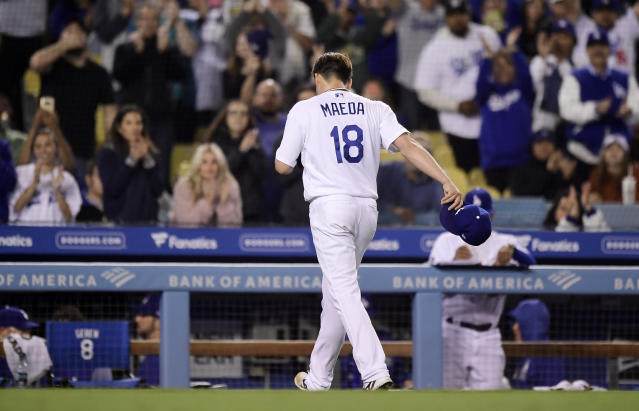 Los Angeles Dodgers starting pitcher Kenta Maeda, of Japan, walks back to the dugout as fans cheer, as he was removed during the seventh inning of the team's baseball game against the San Diego Padres on Wednesday, May 15, 2019, in Los Angeles. (AP Photo/Mark J. Terrill)