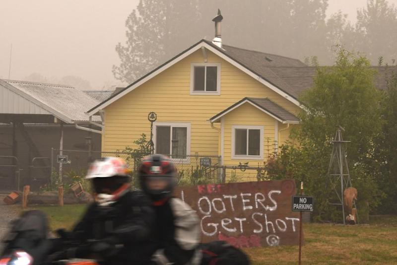 A sign reads 'Looters Get Shot' outside a residence in Molalla, Oregon on Sunday.