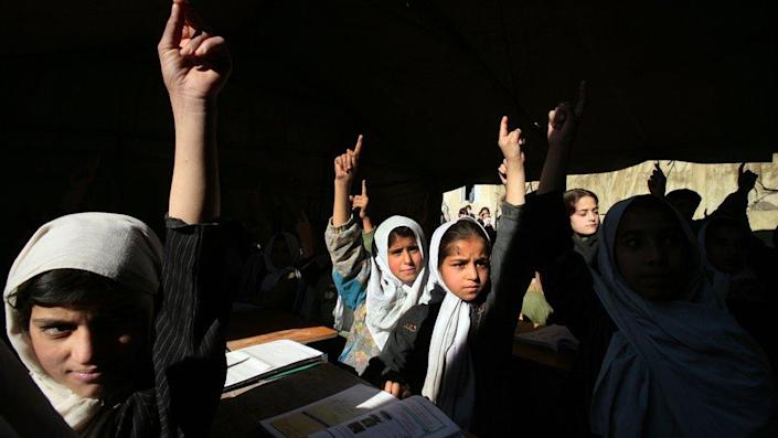 Afghan girls in school prior to the Taliban take over