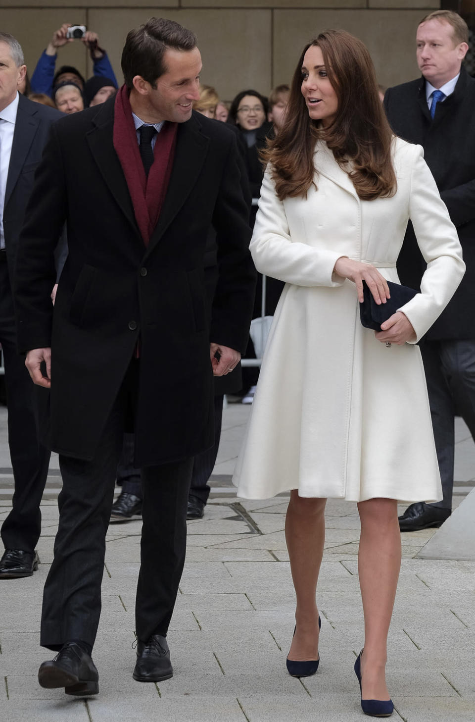 <p>Kate wore another Max Mara coat - this time, in stark white - for a Portsmouth engagement. As before, she paired the look with Jimmy Choos and a suede L.K. Bennett clutch. </p><p><i>[Photo: PA]</i></p>