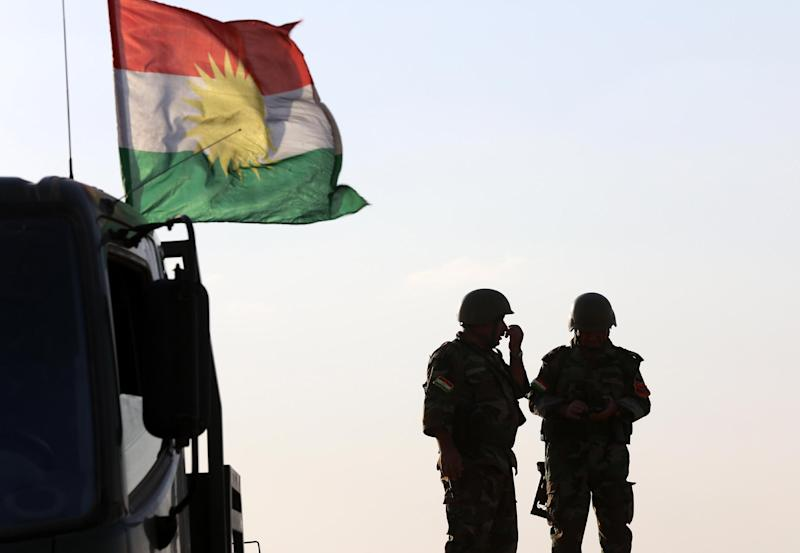 Iraqi Kurdish Peshmerga fighters hold a position on the front line in Khazer, west of Arbil on September 16, 2014