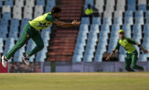 Pakistan's bowler Haris Rauf attempts fielding his own bowling during the fourth and final T20 cricket match between South Africa and Pakistan at Centurion Park in Pretoria, South Africa, Friday, April 16, 2021. (AP Photo/Themba Hadebe)