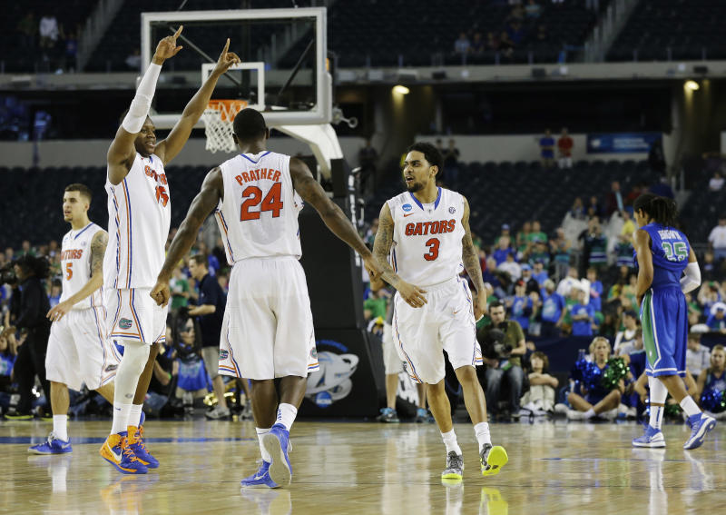 Florida's Scottie Wilbekin (5) Will Yeguete (15), Casey Prather (24) and Mike Rosario (3) react as Florida Gulf Coast's Sherwood Brown (25) leaves the floor after a regional semifinal game in the NCAA college basketball tournament, Saturday, March 30, 2013, in Arlington, Texas. Florida won 62-50. (AP Photo/Tony Gutierrez)