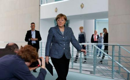 German Chancellor Merkel arrives to give statement on Turkey's request to seek prosecution of German comedian in Berlin