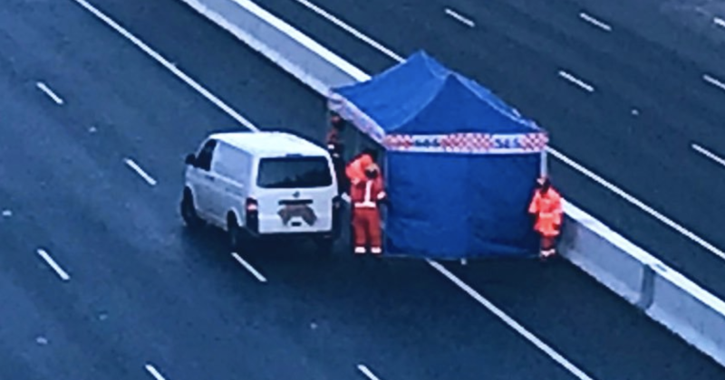 Pictured is an SES tent on the Eastlink freeway in Melbourne next to a white van.