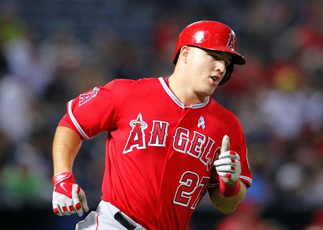 Los Angeles Angels Mike Trout (27) rounds first base after hitting a home run in the third inning inning of an interleague baseball game against the Atlanta Braves Sunday, June 15, 2014, in Atlanta. (AP Photo/Todd Kirkland)