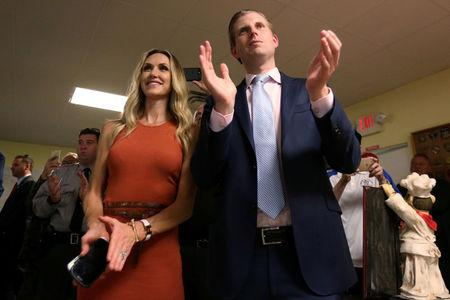 FILE PHOTO: Eric Trump, son of Republican presidential candidate Donald Trump, and his wife Lara Yunaska during a campaign event in Statesville