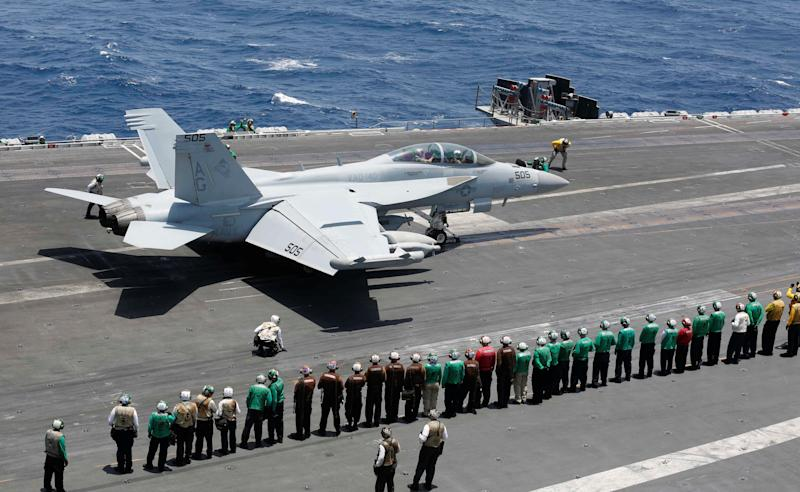 Sailors line up and watch Capt. William R. Reed, commander of Carrier Air Wing (CVW) 7, launch from the flight deck of the Nimitz-class aircraft carrier USS Abraham Lincoln (CVN 72) during an aerial change of command, in Arabian Sea, May 30, 2019. Picture taken May 30, 2019. Catie Coylei/U.S. Navy/Handout via REUTERS ATTENTION EDITORS- THIS IMAGE HAS BEEN SUPPLIED BY A THIRD PARTY.