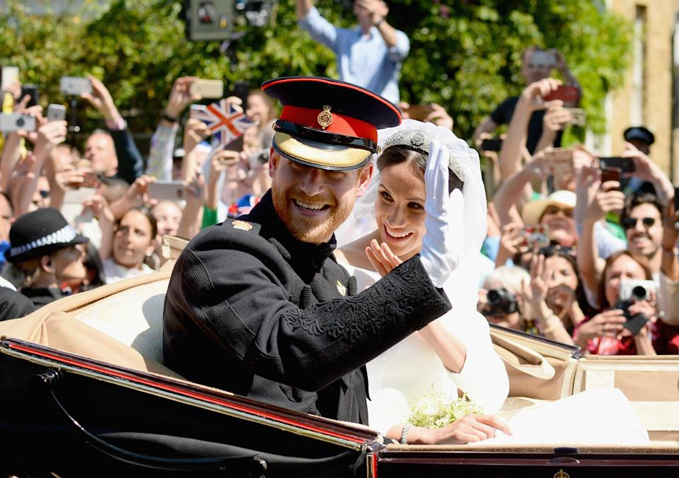 Happy moment: The newlyweds smile for the crowds as they're driven through Windsor. (Getty)