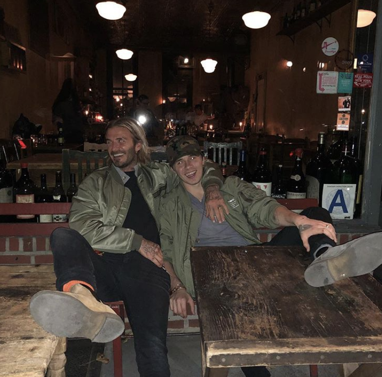 """<p>It was boys' night for the soccer star and his oldest son, Brooklyn Beckham, where the handsome duo indulged in some classic New York eats. """"Just relaxing after eating the best pizza in NYC @lucali_bk,"""" the elder Beckham wrote. """"We don't look happy at all lol."""" Let's hope the eatery keeps its """"A"""" rating despite its customers putting their feet on the tables. (Photo: <a rel=""""nofollow noopener"""" href=""""https://www.instagram.com/p/BbQovcahL6d/?taken-by=davidbeckham"""" target=""""_blank"""" data-ylk=""""slk:David Beckham via Instagram"""" class=""""link rapid-noclick-resp"""">David Beckham via Instagram</a>) </p>"""