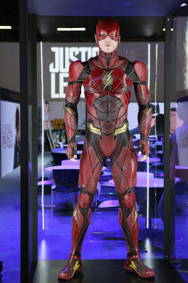 <p>Briefly glimpsed in <i>Batman v Superman</i>, Ezra Miller's <em>Injustice</em>-inspired Speed Force-channeling supersuit is distinct from the TV show. (Credit: Warner Bros.) </p>