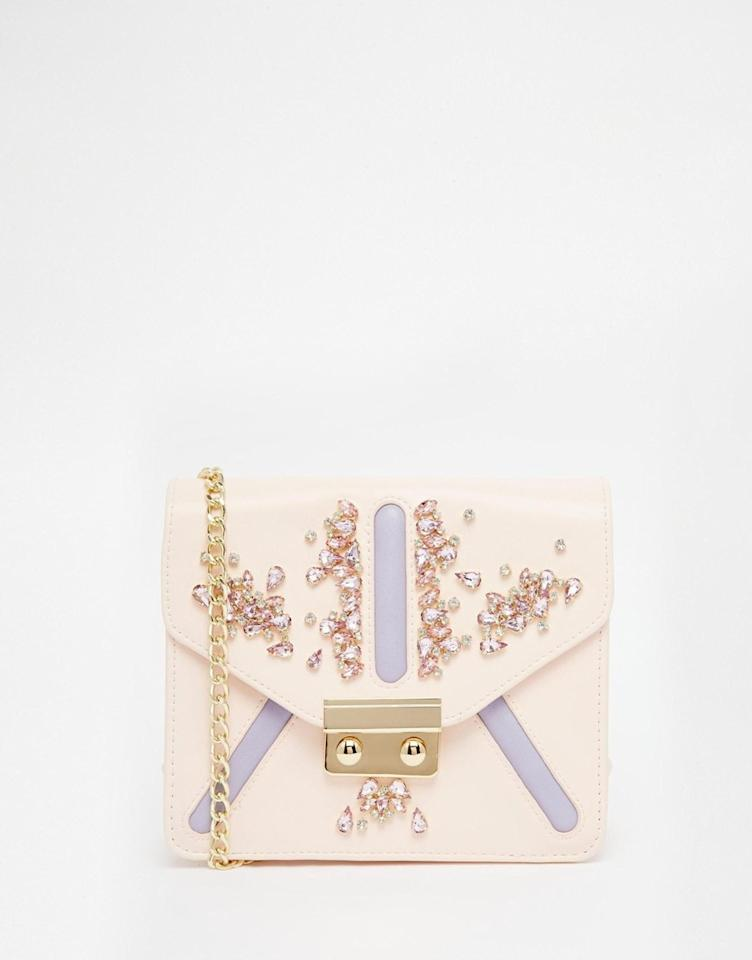 "<p>An embellished bag can take an outfit from zero to hero. We have fallen head over heels for this ASOS design.<i><a href=""http://www.asos.com/asos/asos-embellished-chain-cross-body-bag/prod/pgeproduct.aspx?iid=5930697&clr=Multi&SearchQuery=chain+bag&pgesize=36&pge=0&totalstyles=49&gridsize=3&gridrow=3&gridcolumn=3""> [ASOS, £28]</a></i></p>"