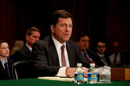 FILE PHOTO: Jay Clayton testifies at a Senate Banking, Housing and Urban Affairs Committee hearing on his nomination of to be chairman of the Securities and Exchange Commission (SEC) on Capitol Hill in Washington, DC, U.S. on March 23, 2017.     REUTERS/Jonathan Ernst/File Photo