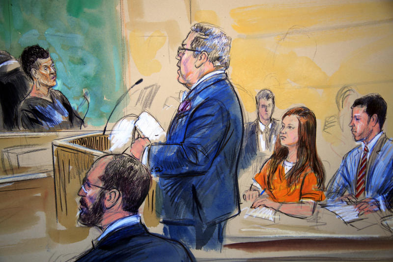This courtroom sketch depicts Maria Butina, in orange suit, during a hearing in federal court in Washington, D.C., in July. (Dana Verkouteren via ASSOCIATED PRESS)