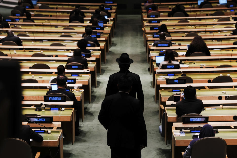 Delegates walk into the annual gathering for the 76th session of the United Nations General Assembly (UNGA) Tuesday, Sept. 21, 2021. (Spencer Platt/Pool Photo via AP)