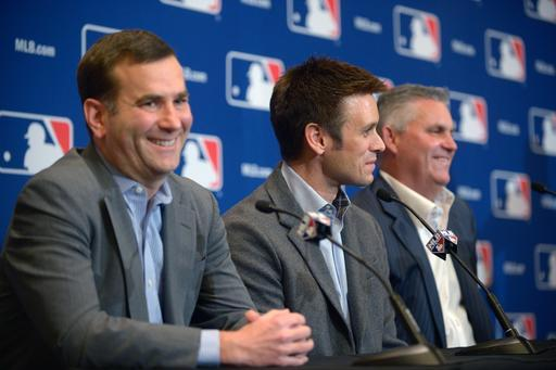 Chicago White Sox general manager Rick Hahn, left, Los Angeles Angels general manager Jerry Dipoto, center, and Arizona Diamondbacks general manager Kevin Towers address reporters after announcing a trade between the three clubs at baseball's winter meetings in Lake Buena Vista, Fla., Tuesday, Dec. 10, 2013. (AP Photo/Phelan M. Ebenhack)