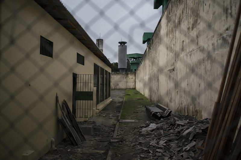 This Feb. 2, 2017 photo shows debris and parts of a roof damaged during the New Year's Day massacre at the Anisio Jobim penitentiary complex, known by its Portuguese acronym of Compaj, in Manaus, Brazil. The bloodshed on New Year's Day at the prison is the worst at any Brazilian prison in the past 25 years. In total, 57 prisoners were killed by rival gang members, 39 of them beheaded. (AP Photo/Felipe Dana)