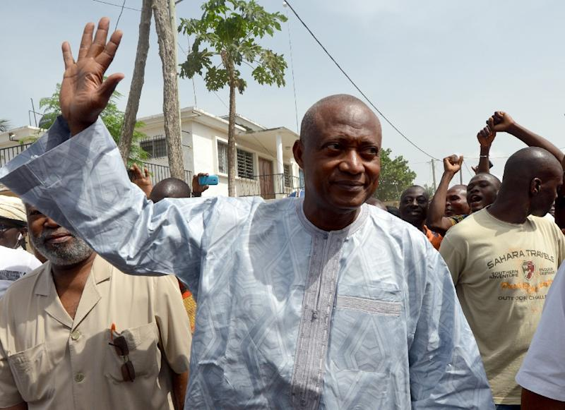 Togo's Opposition leader and candidate for Alliance for National Change Jean-Pierre Fabre arrives at a polling station before voting in the presidential election in Lome on April 25, 2015 (AFP Photo/Issouf Sanogo)