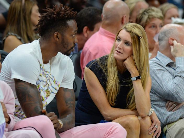 Kelly Loeffler (right) speaks with NBA player Dwight Howard at a 2019 Atlanta Dream game.