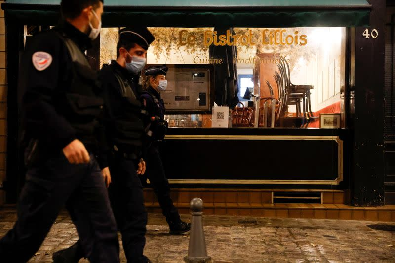Police officers patrol in the streets of Lille during the start of the late-night curfew due to restrictions against the spread of the coronavirus disease (COVID-19), in Lille