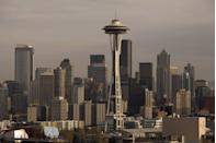 """<p>The 605-foot-tall Space Needle in downtown Seattle offered a futuristic take on life when built to commemorate the 1962 World's Fair. The <a href=""""https://www.citypass.com/articles/seattle/guide-to-space-needle"""" rel=""""nofollow noopener"""" target=""""_blank"""" data-ylk=""""slk:9,550-ton structure stretches 138 feet wide"""" class=""""link rapid-noclick-resp"""">9,550-ton structure stretches 138 feet wide</a>—and one inch wider on hot days, as the building expands slightly—and offers a defining symbol for the Emerald City. The foundation, though, reaches 30 feet down with 72 bolts, meaning that <a href=""""https://www.mentalfloss.com/article/66548/15-things-you-might-not-know-about-space-needle"""" rel=""""nofollow noopener"""" target=""""_blank"""" data-ylk=""""slk:five feet above ground level"""" class=""""link rapid-noclick-resp"""">five feet above ground level</a> is the needle's center of gravity, ensuring stability.</p>"""
