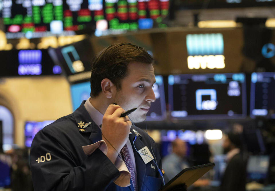 FILE - In this July 5, 2019, file photo trader Benjamin Tuchman works at the New York Stock Exchange in New York. The U.S. stock market opens at 9:30 a.m. EDT on Thursday, July 11. (AP Photo/Mark Lennihan, File)