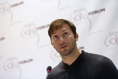 Five-time Olympic gold medallist Australia's Ian Thorpe speaks during the news conference for the Doha Gathering of All Leaders In Sport (GOALS) forum in Doha December 10, 2012. The forum will run from December 10 to 12. REUTERS/Fadi Al-Assaad