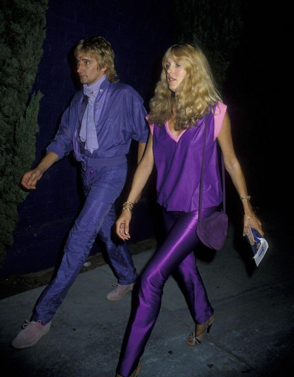 <p>Rod Stewart and Alana Hamilton embrace the disco lifestyle, dressed in head-turning neon outfits, as they arrive at Flipper's Roller Disco in West Hollywood, California for Jacqueline Bisset's birthday party in 1979. </p>