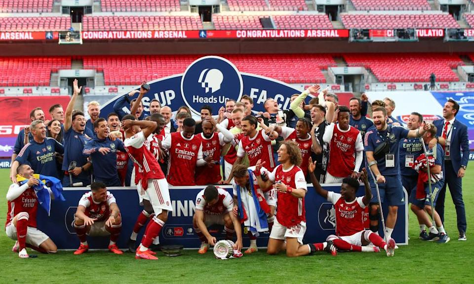 Pierre-Emerick Aubameyang drops the FA Cup after the win against Chelsea