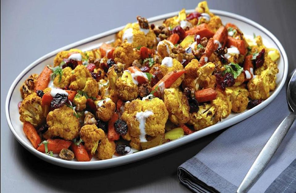 """<p>This grilled cauliflower recipe can be paired as a side dish with your favorite <a href=""""https://www.thedailymeal.com/cook/grilled-chicken-not-boring?referrer=yahoo&category=beauty_food&include_utm=1&utm_medium=referral&utm_source=yahoo&utm_campaign=feed"""" rel=""""nofollow noopener"""" target=""""_blank"""" data-ylk=""""slk:grilled chicken"""" class=""""link rapid-noclick-resp"""">grilled chicken</a>, but you can also eat this savory dish on its own. Add wood chips to your charcoal grill to achieve a super smoky flavor.</p> <p><a href=""""https://www.thedailymeal.com/recipes/cauliflower-carrot-grill-roasted?referrer=yahoo&category=beauty_food&include_utm=1&utm_medium=referral&utm_source=yahoo&utm_campaign=feed"""" rel=""""nofollow noopener"""" target=""""_blank"""" data-ylk=""""slk:For the Wood-smoked Cauliflower and Carrots With Pistachio Crunch recipe, click here."""" class=""""link rapid-noclick-resp"""">For the Wood-smoked Cauliflower and Carrots With Pistachio Crunch recipe, click here.</a></p>"""