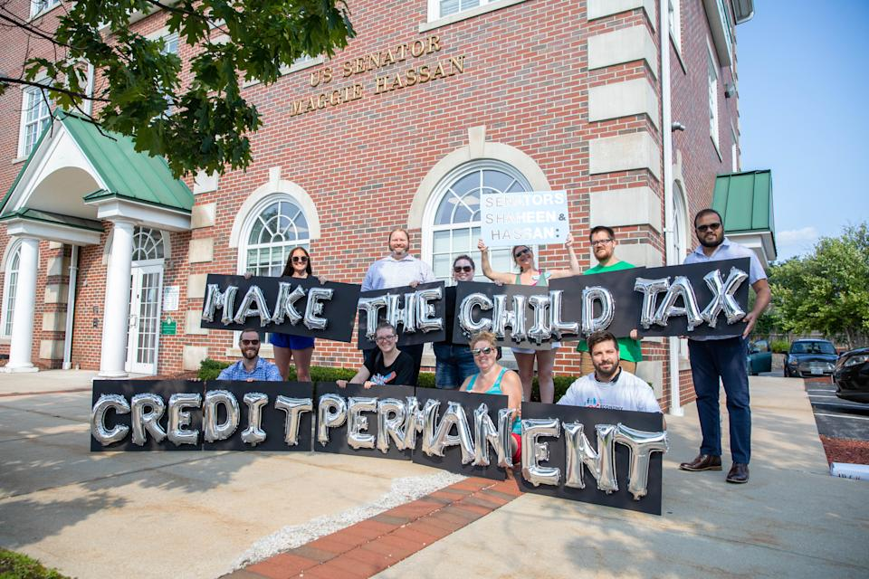 MANCHESTER, NH - SEPTEMBER 14: New Hampshire parents and other supporters gather outside of Senator Hassan's Manchester office to thank her for child tax credit payments and demand they be made permanent on September 14, 2021 in Manchester, New Hampshire.  (Photo by Scott Eisen/Getty Images for ParentsTogether)