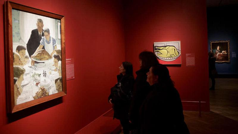 Museum-goers look at Norman Rockwell's Freedom From Want, aka The Thanksgiving Picture
