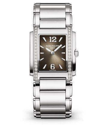 "<p><a class=""link rapid-noclick-resp"" href=""https://www.patek.com/en/collection/twenty4/4910-1200A-010"" rel=""nofollow noopener"" target=""_blank"" data-ylk=""slk:SHOP NOW"">SHOP NOW</a></p><p>Patek Philippe's elegantly understated new timepiece shares its metallic cuff bracelet and contoured case with the bestselling original, which debuted more than 20 years ago. </p><p>This contemporary version has a super-comfortable steel case set with 36 sparkling diamonds, a soft grey-black sunburst dial and gold hour markers and hands. </p><p>Twenty-4 watch, £11,300, <a href=""https://www.patek.com/en/collection/twenty4/4910-1200A-010"" rel=""nofollow noopener"" target=""_blank"" data-ylk=""slk:Patek Philippe"" class=""link rapid-noclick-resp"">Patek Philippe</a></p>"