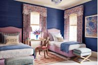"""<p>Designer <a href=""""https://www.katieridder.com/"""" rel=""""nofollow noopener"""" target=""""_blank"""" data-ylk=""""slk:Katie Ridder"""" class=""""link rapid-noclick-resp"""">Katie Ridder</a> layers vibrant cobalt blue walls with flamboyant <a href=""""https://fave.co/2y539qR"""" rel=""""nofollow noopener"""" target=""""_blank"""" data-ylk=""""slk:Studio Four"""" class=""""link rapid-noclick-resp"""">Studio Four</a> drapery and orchid bed upholstery in this balanced Hamptons twin bedroom. The deep blue wallcovering is from <a href=""""https://www.thibautdesign.com/"""" rel=""""nofollow noopener"""" target=""""_blank"""" data-ylk=""""slk:Thibaut"""" class=""""link rapid-noclick-resp"""">Thibaut</a>; the vintage rug is from <a href=""""https://fave.co/2IK97Ub"""" rel=""""nofollow noopener"""" target=""""_blank"""" data-ylk=""""slk:Märta Måås-Fjetterström"""" class=""""link rapid-noclick-resp"""">Märta Måås-Fjetterström</a>.</p>"""