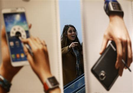 A woman looks at advertisements promoting Samsung Electronics' Galaxy Note 3 smartphone in Seoul