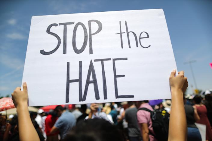 A demonstrator holds a sign reading 'Stop the Hate' at a protest against President Trump's visit following a mass shooting, which left at least 22 people dead, on Aug. 7, 2019 in El Paso, Texas. (Photo: Mario Tama/Getty Images)