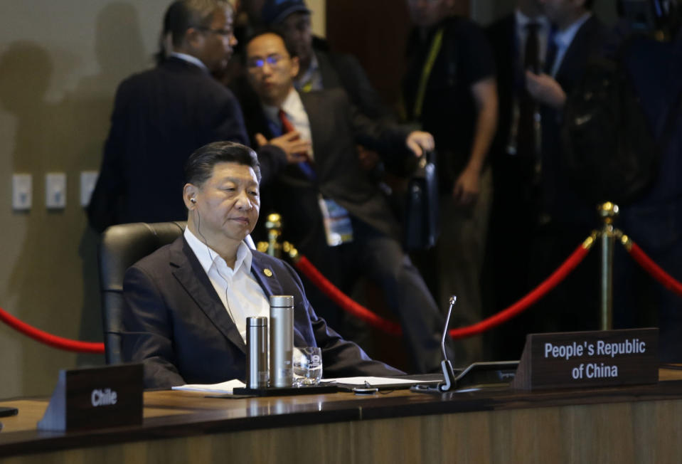 Chinese President Xi Jinping listens during the IMF informal dialogue on the State of the Regional & Global Economy as part of APEC meet activities at Port Moresby, Papua New Guinea on Sunday, Nov. 18, 2018. (AP Photo/Aaron Favila)