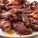 """<p>A good marinade can make your chicken wings absolutely impossible to put down. This sauce is spicy, sweet, and garlicky. It's the perfect combination to keep you reaching for more. The best part, though, is how caramelised and sticky they get in the oven.</p><p>Get the <a href=""""https://www.delish.com/uk/cooking/recipes/a28826419/chicken-wing-marinade-recipe/"""" rel=""""nofollow noopener"""" target=""""_blank"""" data-ylk=""""slk:Spicy Asian Chicken Wings"""" class=""""link rapid-noclick-resp"""">Spicy Asian Chicken Wings</a> recipe.</p>"""