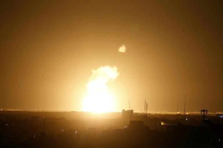 Flames are seen following an Israeli air strike in the town of Khan Yunis, in the southern Gaza Strip, early on November 22, 2020