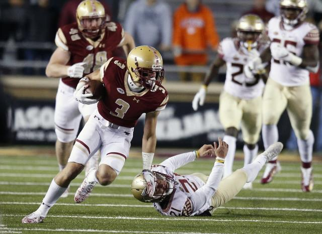 Boston College wide receiver Michael Walker (3) evades Florida State defensive tackle Marvin Wilson (21) during the first half of an NCAA college football game in Boston, Friday, Oct. 27, 2017. (AP Photo/Michael Dwyer)