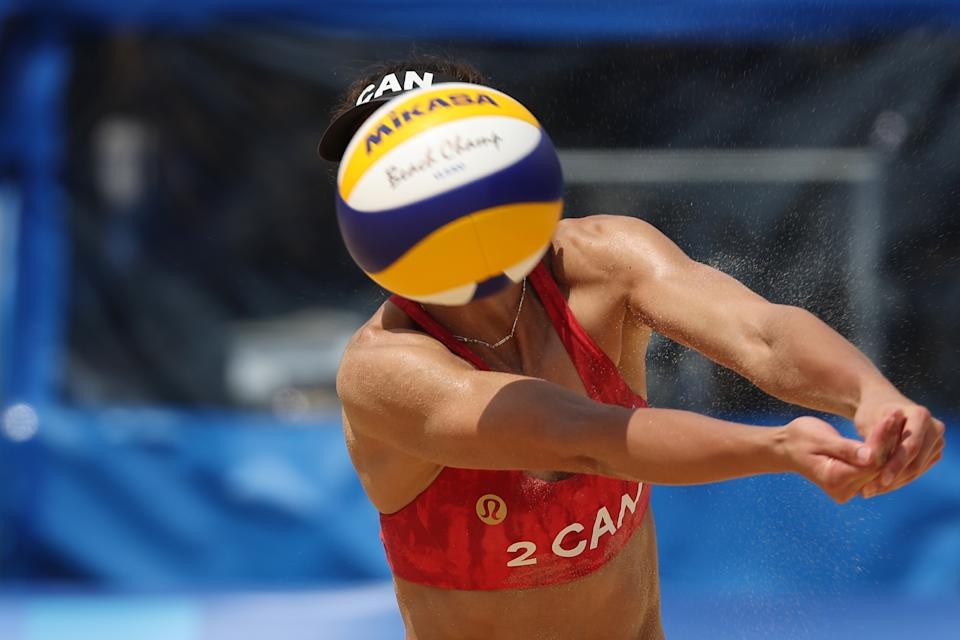 <p>Melissa Humana-Paredes #2 of Team Canada returns the ball against Team Switzerland during the Women's Preliminary - Pool A beach volleyball on day six of the Tokyo 2020 Olympic Games at Shiokaze Park on July 29, 2021 in Tokyo, Japan. (Photo by Sean M. Haffey/Getty Images)</p>