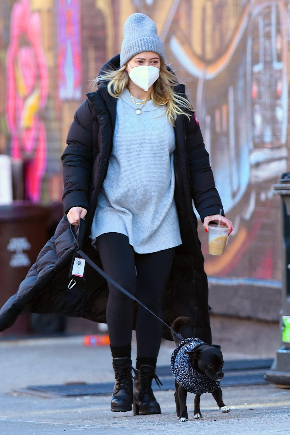 <p>Pregnant Hilary Duff sips an iced coffee while walking her dog on Wednesday in N.Y.C. </p>