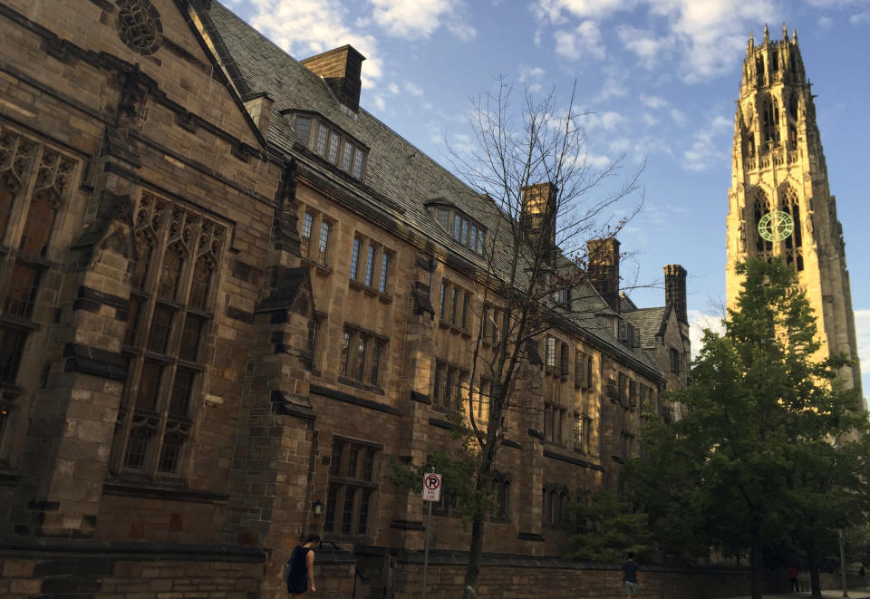 """FILE - This Sept. 9, 2016, file photo shows Harkness Tower on the campus of Yale University in New Haven, Conn. Yale University is requiring its faculty and staff to get coronavirus vaccinations before the 2021 fall term, extending a requirement already imposed for students. The private university says faculty members, staffers and academic trainees must be fully inoculated by Aug. 1, 2021, although there are provisions for exemptions for reasons based on medical conditions or religious or """"strongly held"""" personal beliefs. (AP Photo/Beth J. Harpaz, File)"""