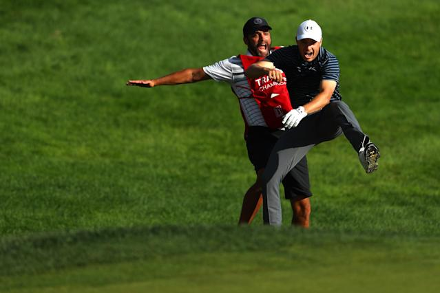 Jordan Spieth (R) wins the Travelers Championship and celebrates with caddy Michael Greller (L) on June 25, 2017. (Getty)