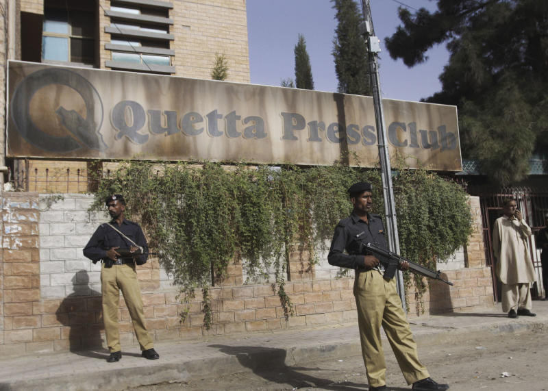In this Friday, Sept. 14, 2012 photo, Pakistani security stand guard in front of the Press Club in Quetta, Pakistan. The telephone call to local journalists generally comes in the late evening. The voice on the other end is usually a Sunni militant with a statement he wants printed threatening of violence or claiming responsibility for attacks that already occurred. Journalists fear being killed if they don't print the messages. (AP Photo/Arshad Butt)